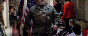 Commander Jim Watts leads Vietnam Veterans of America Chapter 154 through the halls of Glen Peters School. CREDIT: Ross Raybin
