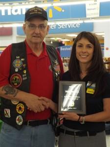 President Terry Yates awards plaque of appreciation to Jennifer Joyce,    Wal-Mart manager. (Photo courtesy of The Lebanon Democrat).