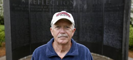 Dan Gannon stands near the Iowa Vietnam War Monument where he helped place a plaque honoring soldiers who returned from war but died as a result of their service. Michael Zamora/The Register