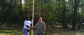 Veteran Charles Russell receives flags, pole as birthday present