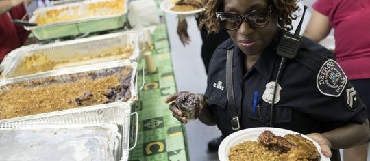 Detroit officer NPO C. Burks-Weathers from the 2nd Precinct takes her lunch during the Detroit Police luncheon on Friday, July 15, 2016 at the Vietnam Veterans of America Post in Detroit. (Photo: Tim Galloway, Special to the Free Press)