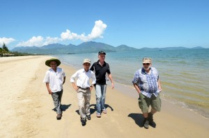 From left: Former Viet Cong members Phan Van Tai and Nguyen Tien,    and former Marines Larry Vetter and Chas Lehmann walk along Red Beach in Da Nang on Sept. 25,    2015. (Erik Slavin/Stars and Stripes)