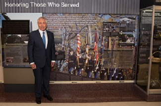 Former Secretary of Defense Chuck Hagel stands next to his quote in a hallway dedicated to veterans of the Vietnam War at the Pentagon in Washington,    D.C.,    Dec. 20,    2016. (DOD photo by U.S. Air Force Staff Sgt. Jette Carr)