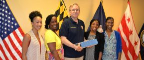Len Ignatowski, Vice President of Vietnam Veterans of America Chapter 227 presents ninety-one $ 50 gift cards to local Veteran Administration case workers for back-to-school needs of homeless veteran children. Left to Right: Miracle Hallman, Ky'Neihe King, Leonard Ignatowski, Vice President VVA Chapter 227, Janell Scott, Yolanda Peay. Photo by Gary Strange, Veterans Administration.