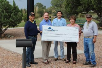 Chapter 358 accepts check from First American Bank. From left, VVA member Armando Amador, First American Bank Market President Joel Schram, VVA member David Pratesi, First American Bank VP Cecilia Pacheco, and VVA member Paul Madrid. Photo courtesy Mary Alice Murphy, The Grant County Beat.