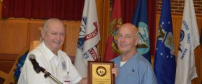 Gary Newman (left) presents Ed Shook the VVA Incarcerated Member of the Year award.