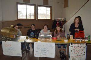 Fundraising for Santa Claus visit during the Gogebic-Iron Range Chapter 529's steak dinner